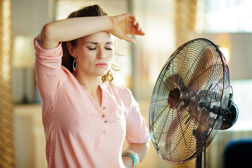 woman in front of fan