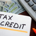 Tax credit with money and calculator