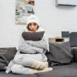 Cold woman on a couch
