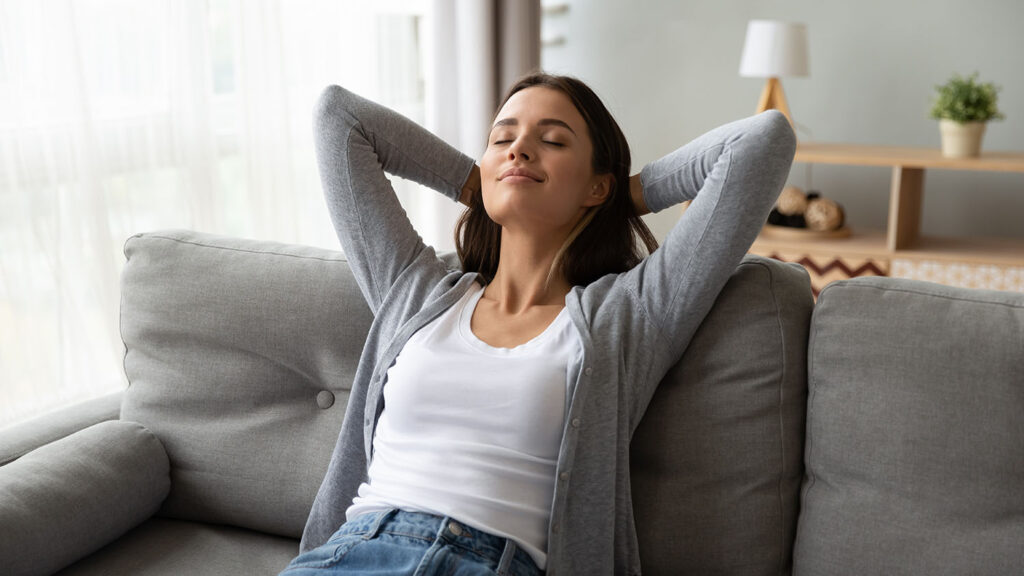 A woman relaxing on a couch
