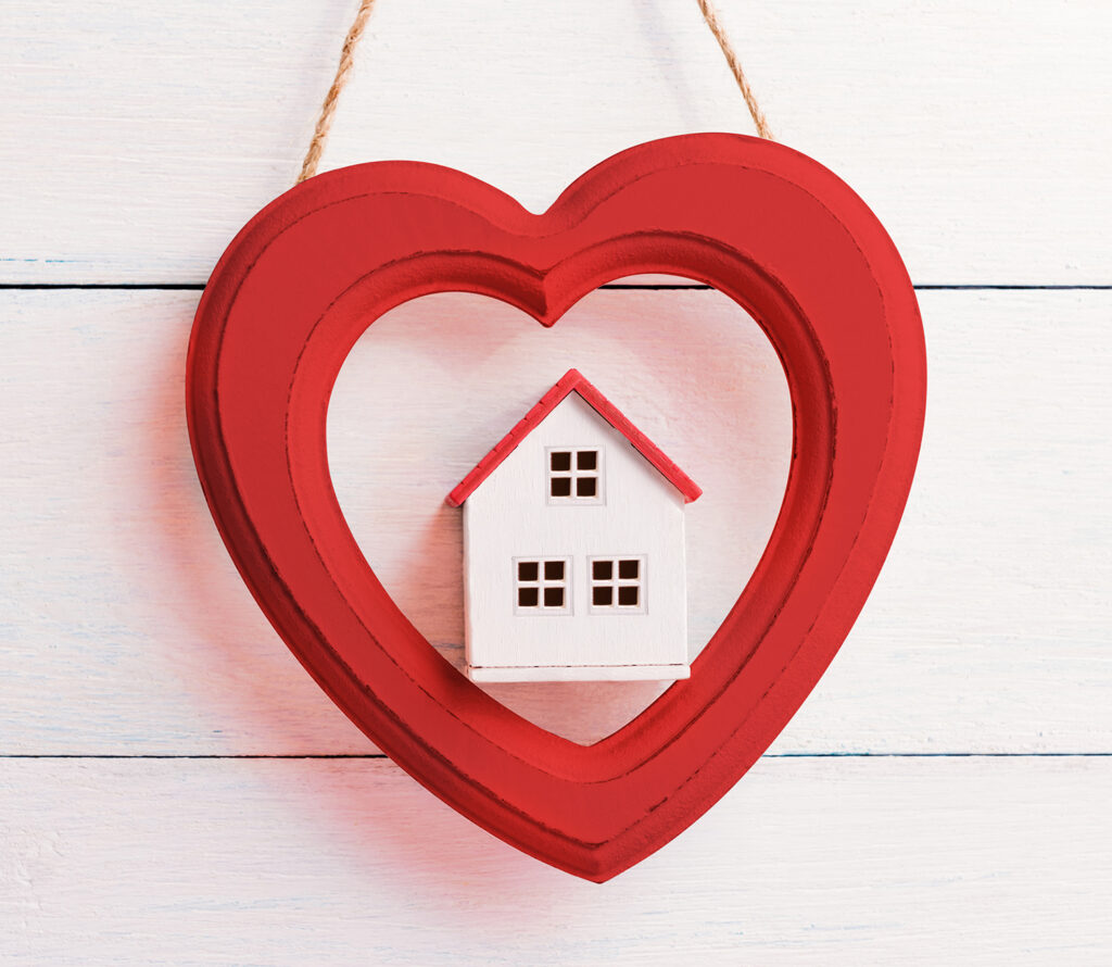 A heart decoration with a house in the middle