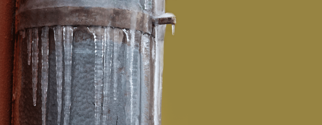 Water frozen on the outside of a pipe