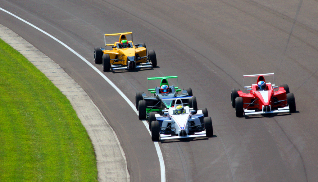Race cars on Indy Speedway track